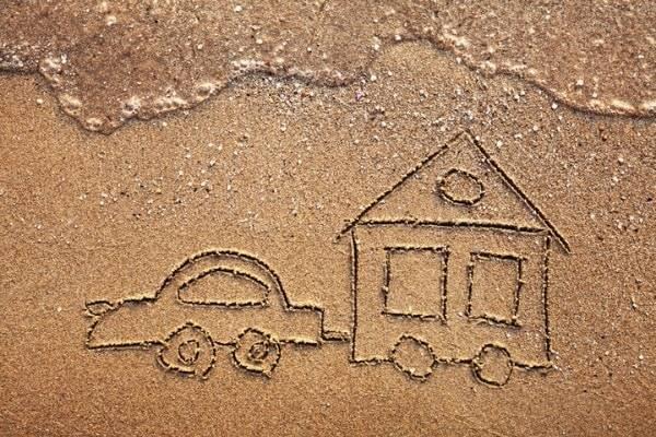 caravan image drawn on sand