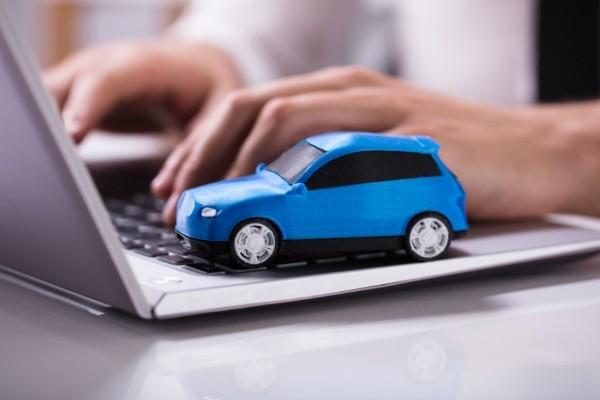 blue car on a laptop