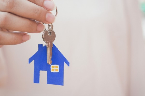 landlord holding a house key