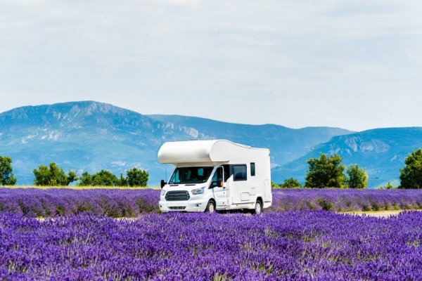 Motorhome driving on a country road in a beautiful landscape view