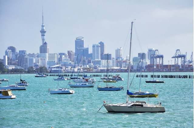 boats on ocean close to sky tower