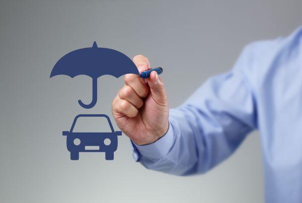 Blue car, umbrella and pen