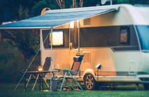 caravan is parked on a quiet corner