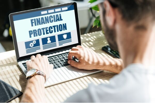 man searching for financial protection online