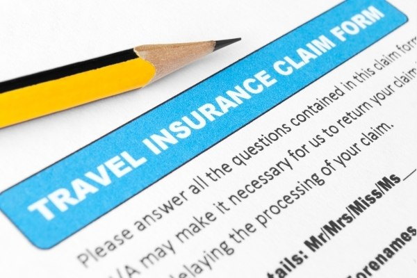 A travel insurance claim form with a pencil