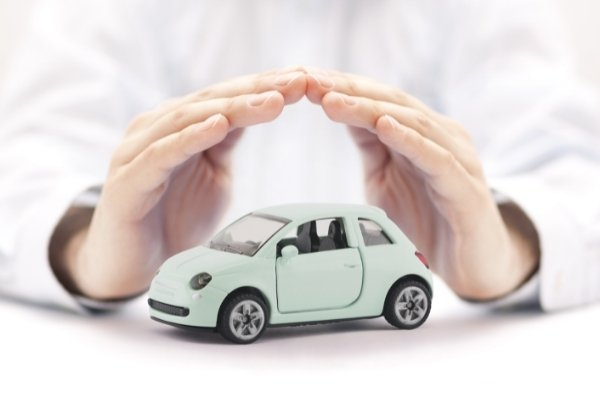 Small toy car covered by hands